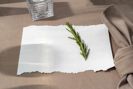 A plate with a white sheet on it. Wedding table with seating for guests.