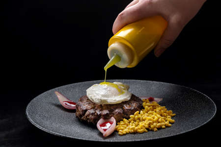 Fried venison steak with poached egg and boiled barley.