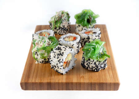 Shiitaki and chuka, beautiful rolls decorated with seaweed. Sprinkled with white and black sesame seeds.