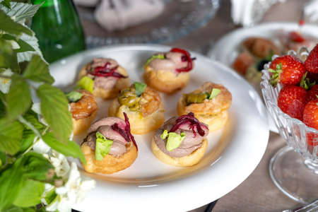 Savory profiteroles with different types of fillings. An exquisite French snack for a buffet at the feast. Standard-Bild