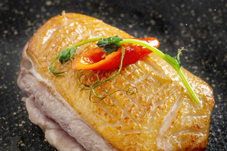 Roasted Duck Meat with Tomatoes, Small Green Sprouts and Sauce.