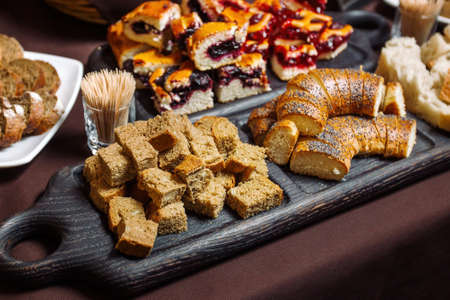 Samples Homemade Bread, a table with sliced bread. Tasting of bread products. Reklamní fotografie