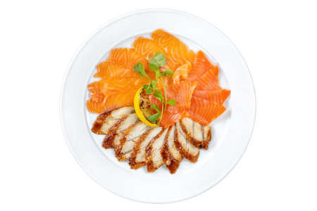 Salmon and eel, sliced on a white plate, with lemon. Decorated with parsley.