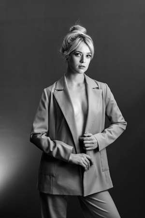 Sexy young blonde, a jacket dressed on a naked body