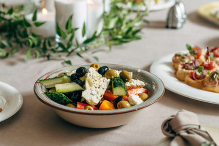 Greek salad with feta cheese, juicy tomatoes, red pepper, cucumber and lettuce.