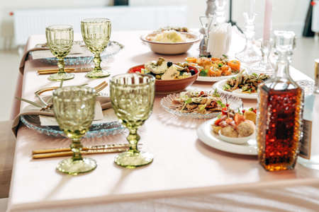 Beautiful festive table, with Greek salad with feta cheese.