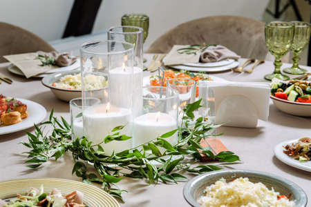 Beautiful table setting with candles and utensils
