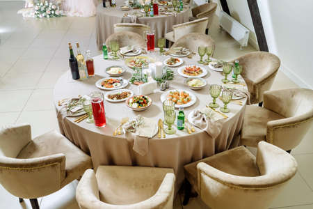 Beautiful served tables, wedding event. Lots of food and drinks.