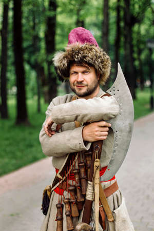City Cossack 1st half of the 17th century. In a caftan, a fur hat in the hands of birding. Reklamní fotografie