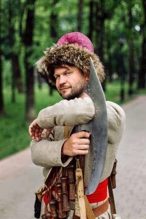 City Cossack 1st half of the 17th century. In a caftan, a fur hat in the hands of birding. Got one eye open. Reklamní fotografie