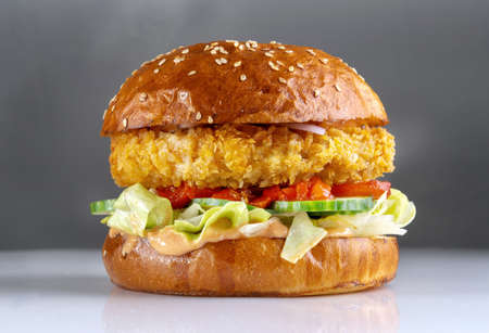 Shrimp burger, a cutlet made with minced shrimp. With cheese, tomatoes and sesame seed bun.