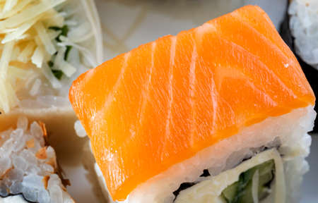 Roll Philadelphia with salmon, cucumber and cream cheese, beautiful fish texture. Reklamní fotografie