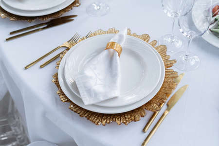 Beautiful served table, golden dishes, top view. Wedding event.
