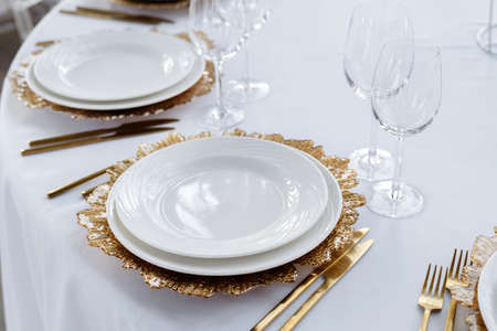 Beautiful served table, golden dishes, top view. Wedding event, luxury catering.