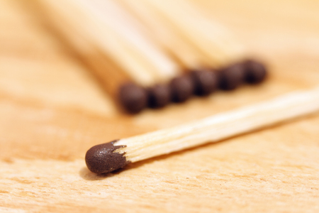 Matches close-up on a wooden background