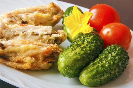 Fresh natural gherkins and organic tomatoes to poultry chicken meat. Healthy food.