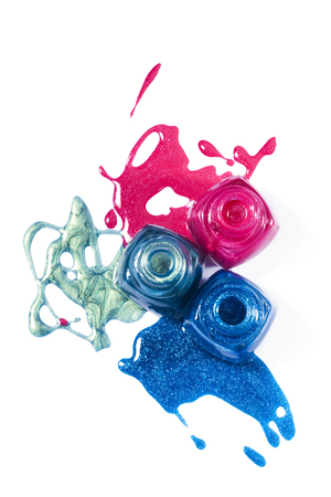 Top view of pink, blue, marine shimmering nail polish on white background Stock Photo