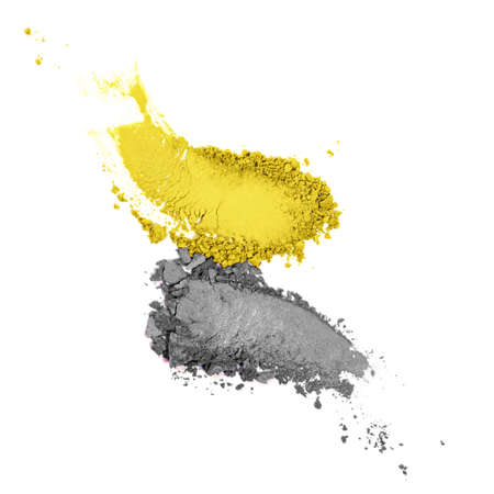 Strokes or samples of makeup of main colour of the year. Close up of trendy toned crushed cosmetics. Color of the year 2021illuminating and ultimate gray background. Main color trend.