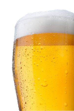 Fresh glass of pils beer with froth and condensed water pearls isolated on white background  Stock Photo