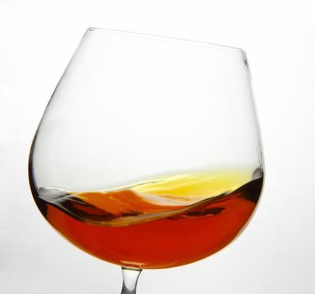 snifter: Cognac Snifter glass with liquid inside