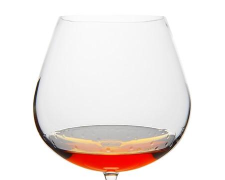 snifter: Cognac Snifter glass with liquid amber inside