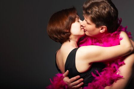 Close-up of a young couple kissing each other photo