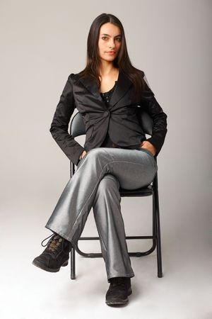 A young attractive woman sitting on armchair