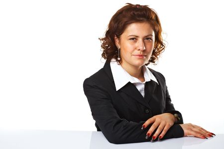 Pretty confident business woman with hands folded, against white background Stock Photo - 5509109