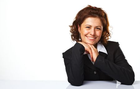 Image of a happy business woman smiling against white background Stock Photo - 5509083