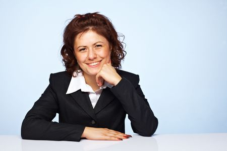 Image of a happy business woman smiling against blue background Stock Photo - 5509106