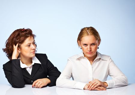 Pretty confident business women against light background Stock Photo - 5509084