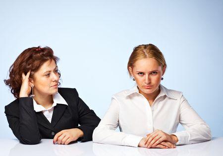 Pretty confident business women against light background Stock Photo - 5509084