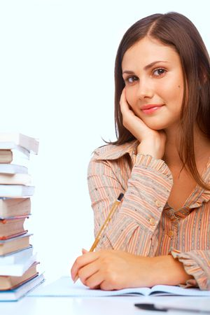 Close-up of teenage girl smiling against light blue background