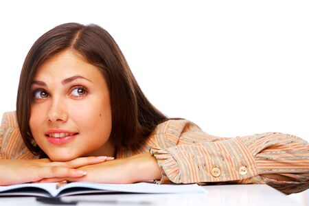 Beautiful female student smiling and looking away over white background Stock Photo