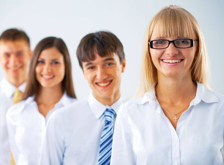 Portrait of happy business group standing in a row Stock Photo - 5807004