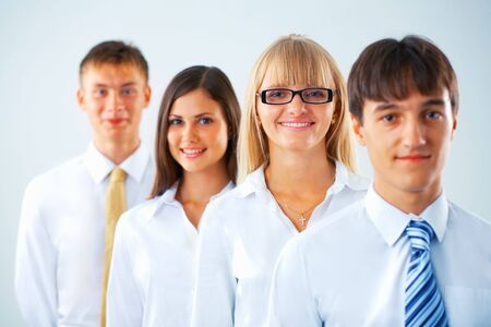 Portrait of happy business group standing in a row Stock Photo - 5807005