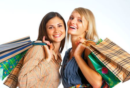 Close-up image of two happy shopers with parcels on white background Stock Photo - 5807151