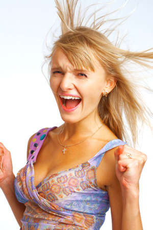 Shouting blond woman with hair flying on white background Stock Photo - 5851837