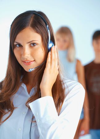 Young beautiful woman with headset with some people at the background