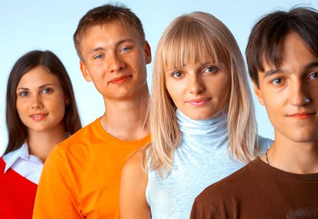 Young people standing in a row on light blue background Stock Photo - 5942560