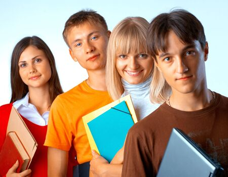 Casual group of college students smiling stand in a row with books on white  Stock Photo - 5942558
