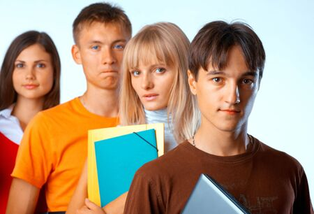 Casual group of college students smiling stand in a row with books on white Stock Photo - 5942557
