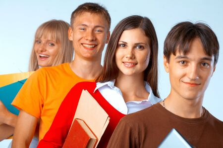 Casual group of college students smiling stand in a row with books on white  Stock Photo - 5942548