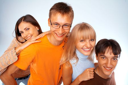 Young friends laughing together standing in a row Stock Photo - 5942562