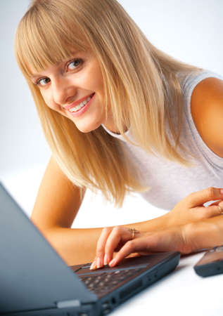Close-up portrait of a woman with laptop photo