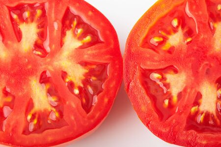 Tomatoes cut in two halves photo