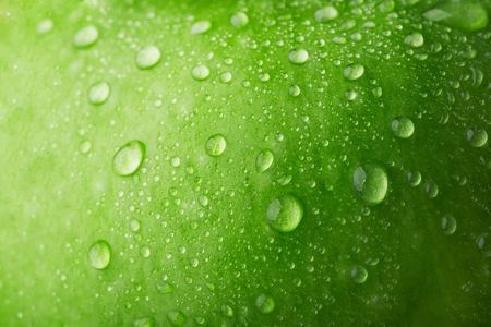 Water drop on green apple surface Stock Photo