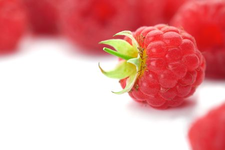 Raspberries with green leaves.This image is focused on one of them