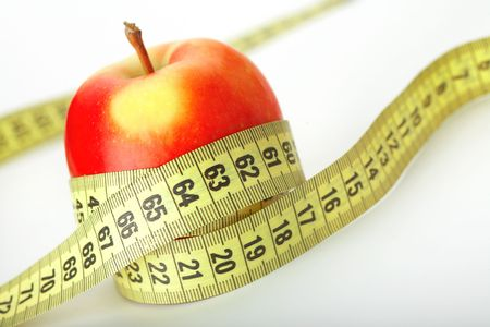 Red apple with a measuring tape on white Stock Photo - 5925019