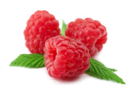 Raspberries with green leaves on white background Stock Photo